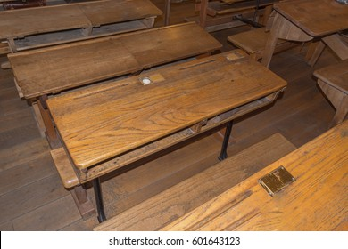 Old historic classroom with school desks.