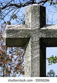 old historic cross statue in autumn cemetery