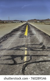 The old and historic damaged route 66 in the desert in Arizona in a bright and hot day of summer.