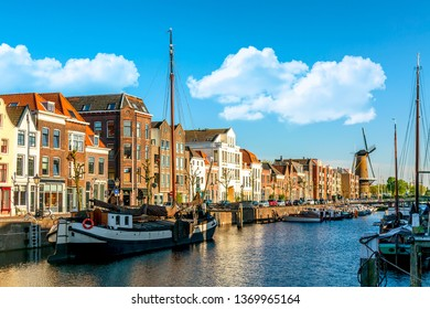 Old historic district Delfshaven with wildmill and houseboats in Rotterdam, South Holland, The Netherlands. Summer sunny day.