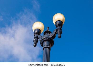 old historic lantern in the gaslamp quarter in San Diego under blue sky