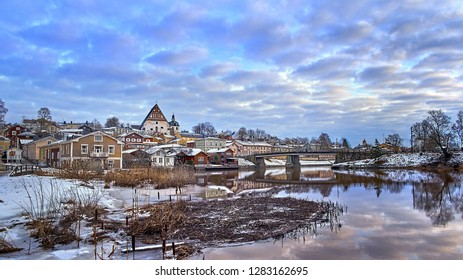 Old historic Porvoo, Finland with wooden houses and medieval stone and brick Porvoo Cathedral at blue hour sunrise.