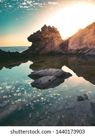 Old historic quarry of sand stones at the coastline with natural pool at colorful sunset light. El ToroClot d'es Moro, Mallorca, Spain, Balearic Islands