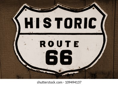 Old historic route 66 sign in sepia