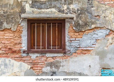 Old historical brick wall with window cage