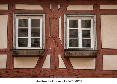 Old historical building and half-timber house with red wood