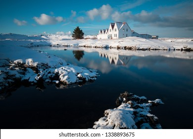 Old historical building at Reykjanes peninsula in Iceland.  Beautiful sunset water reflection. Most popular place in golden circle.
