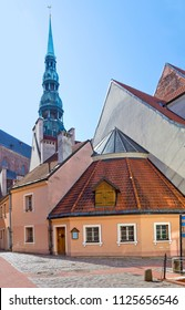 Old historical buildings with spire of St Peter's church in Riga, Latvia