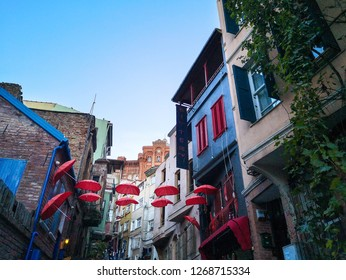 Old historical buildings and street with red umbrellas in Balat, Balat, Istanbul, Turkey, 13.10.2018