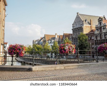 Old historical houses at the old salt wharf next to the river Dyle in the city center of Mechelen, Belgium