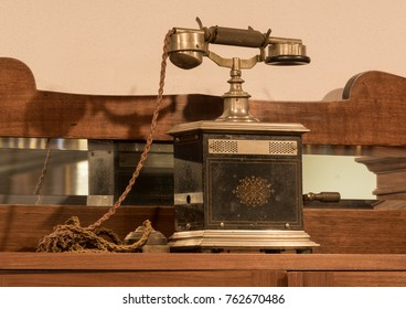 Old historical phone in metal box and textil covered cable