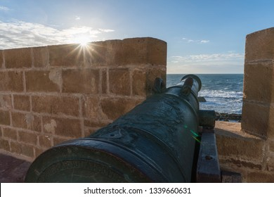 old Historical portugese Heavy Classical Metal Cannons In a Fortress Sunset Time at the seaside view From Fort on Essaouira in Morocco on the Coast of Atlantic Ocean