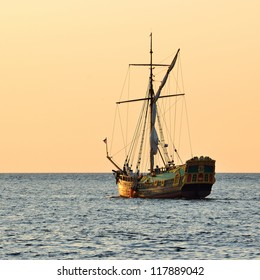 old historical sail ship at the sunset