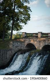 old historical stone bridge, romantic view on the dam