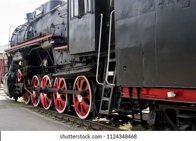 Old historical train. Metal locomotive construction.