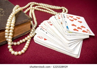 Old holy bible and cards on wooden table. Misticism and fortune telling, future prediction concept.
