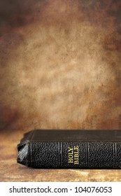 Old Holy Bible, over a grunge stone background.  Lots of copy-space.