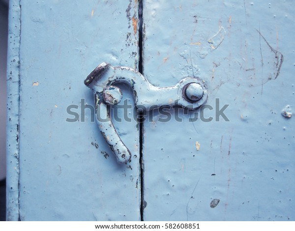 Old hook-constipation on a wooden box covered with different paint color