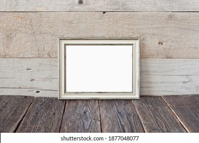 Old horizontal frame on a wooden background. A vintage mockup to showcase your artwork.