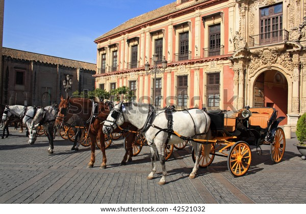 Old horse drawn carriage around  Seville Cathedral