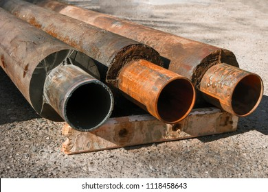 Old Hot Water Pipes With Thermal Insulation Ends Extruded from trench