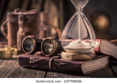 Old hourglass and journal as a concept of journey diary