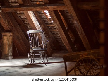 Old house attic with retro furniture, wooden rocking chair. Abandoned home concept.