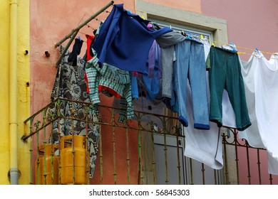 Old house and balcony with hanged clothes