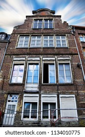 Old house in Belgium from the outside, Ghent, Brussel, Antwerp city buildings blue sky with white clouds on summer day