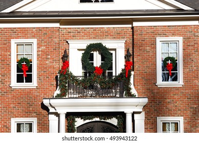 old house decorating with Christmas wreath