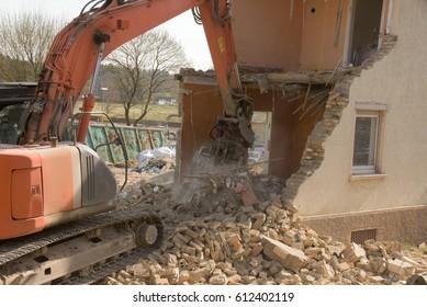 Old house is demolished with excavator