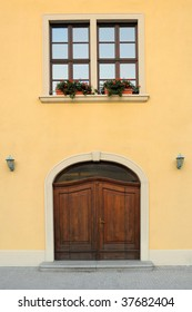old house entrance door, vertical photo, flower-pot in window