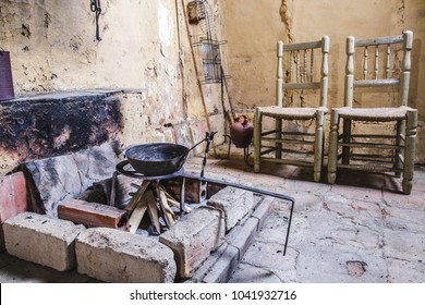 Old house kitchen fireplace cooking set with chairs