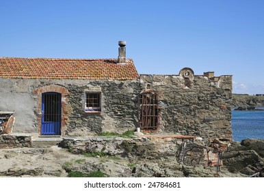 an old house next to the sea