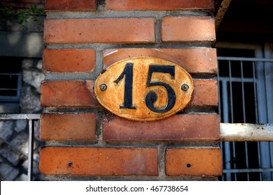 Old house number 15 on a brick wall