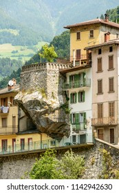 old house on big cantilever rock, shot in bright summer light at Dezzo di Scalve, Bergamo, Orobie, Lombardy, Italy