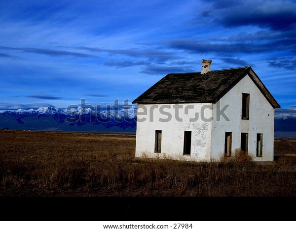 Old house on an open range.