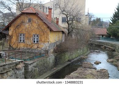 Old house on shore of Bratřejovka river in Vizovice, Zlín region, Czech republic