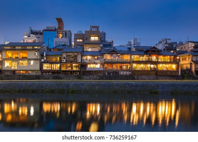 Old house and restaurant in Kamo river or kamogawa river at sunset