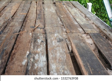 Old house roof with bad wet wooden beams and wet rock wool insulation material. Roofing construction