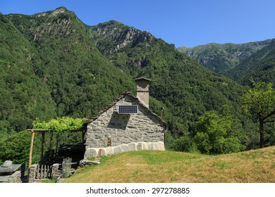 Old house with solar panel in the mountains of Ticino, Switzerland