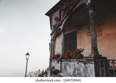 old house in the square of the sacred mountain of Varese in cloudy day, Italy.