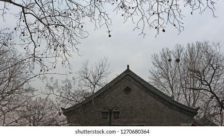 An old house and tree branches in winter in Jinan, China