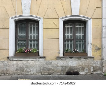 Old house walls with windows bars