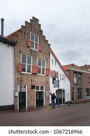 Old house window cleaning by man in the town of Brielle (Brill in English) Netherlands