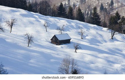 old house in winter mountain landscape
