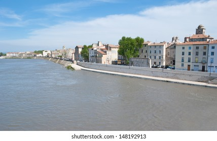 The old houses of Arles and Rhone river well suited to each other in colour. Beige is always in trend here.