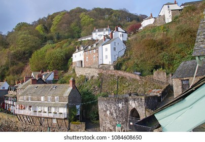 Old houses in the fishing village of Clovelly, running up the hill on a sunny day