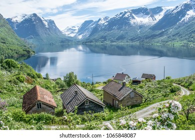 Old houses infront of magical view .  Photo taken on Flo in Oppstryn , in Norway .