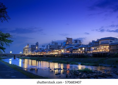 Old houses and restaurants along the Kamogawa (Kamo river) in Kyoto, Japan,at dusk.